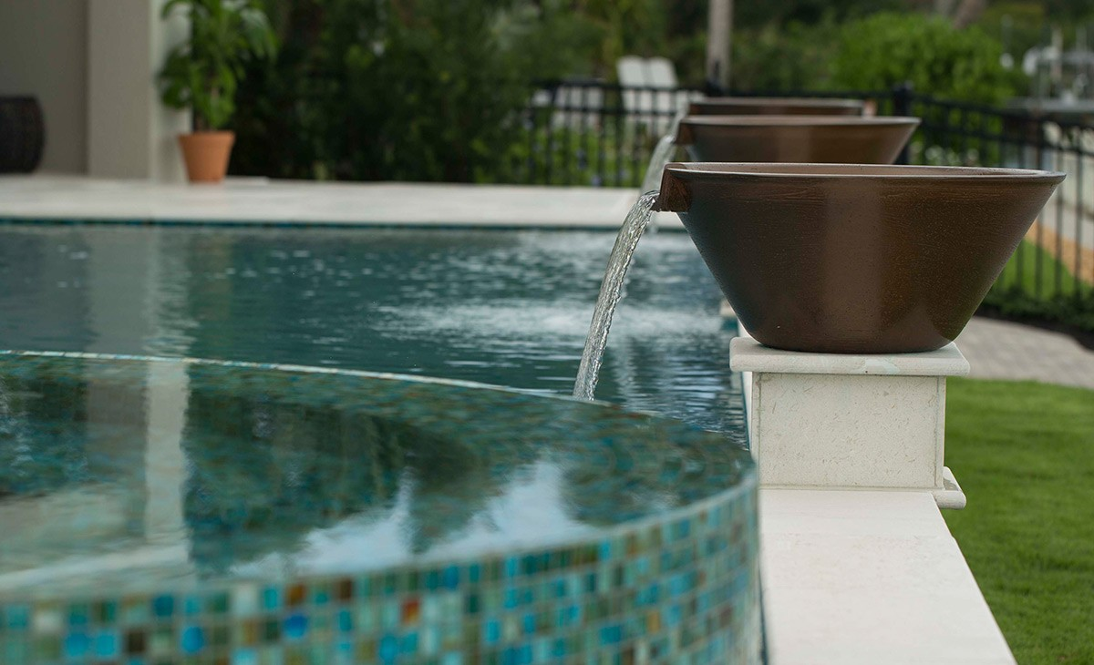 Pool spillover bowl-Broward Custom Concrete Solutions-We offer custom concrete solutions including Polished concrete, Stained concrete, Epoxy Floor, Sealed concrete, Stamped concrete, Concrete overlay, Concrete countertops, Concrete summer kitchens, Driveway repairs, Concrete pool water falls, and more